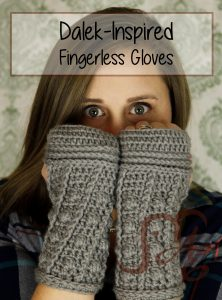 Woman wearing crochet fingerless gloves in grey with a Dalek-theme