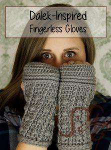 Woman wearing crochet fingerless gloves in grey with a Dalek-theme