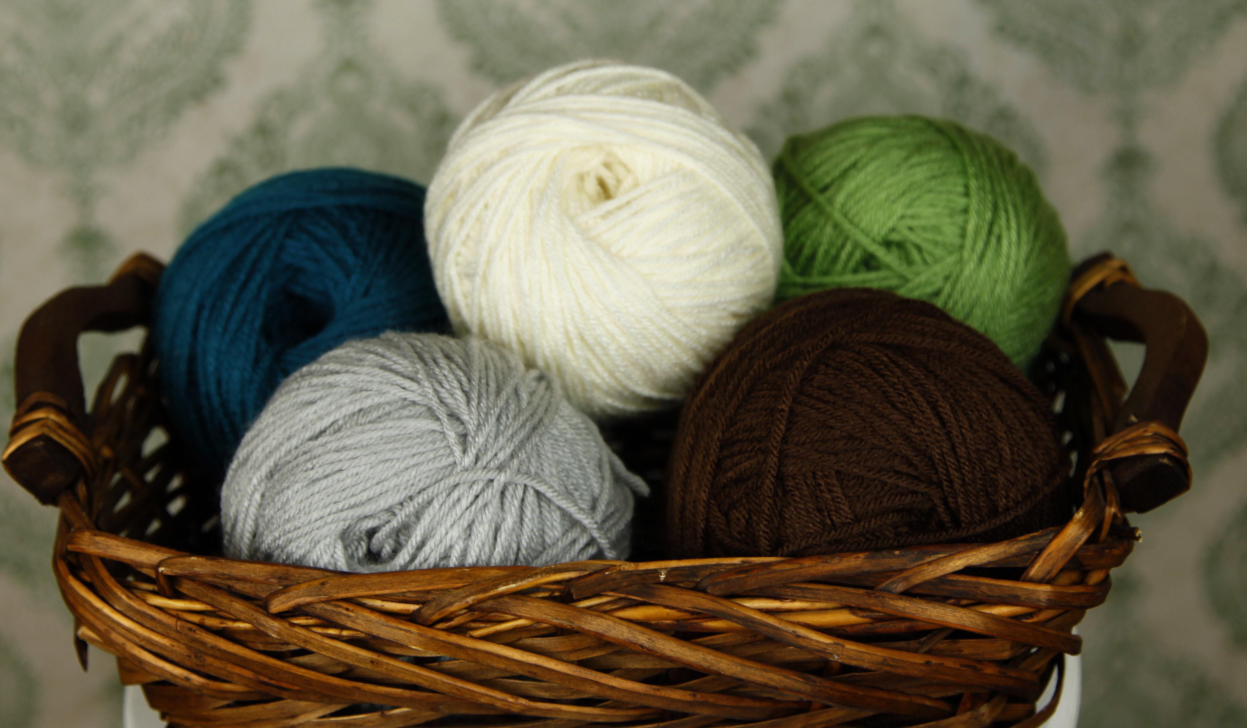 Wicker basket holding balled up yarn