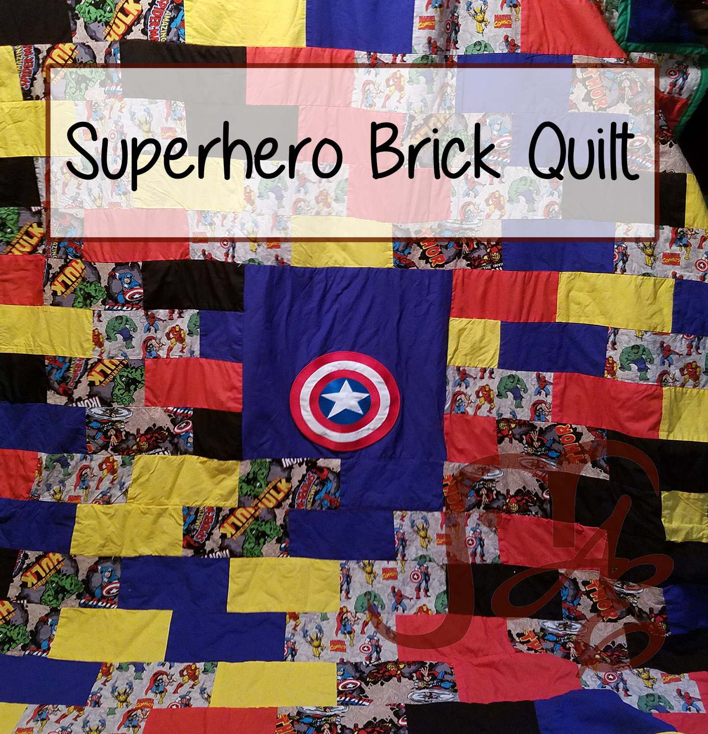 Quilt with superhero fabric in a brick pattern