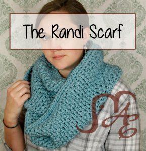 Woman wearing light blue crochet infinity scarf