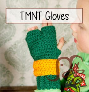 Boy wearing crochet fingerless turtle gloves with orange wrist wraps