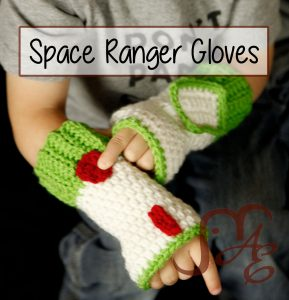 Crochet space ranger fingerless gloves in white and green