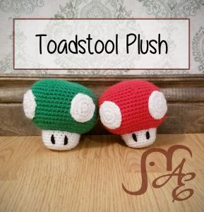 Green and red crochet toadstool plushes