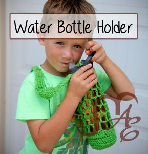 Boy holding crochet water bottle holder