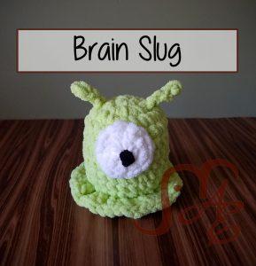 Green alien blob, crochet brain slug