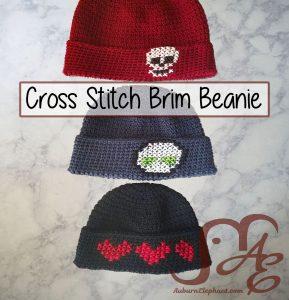 Three crochet beanies with cross stitch designs on brim