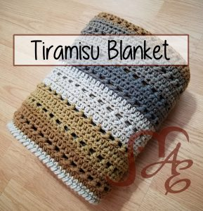 Folded crochet Tiramisu blanket in brown and grey tones