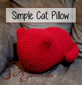 Crochet red pillow in the shape of a cat