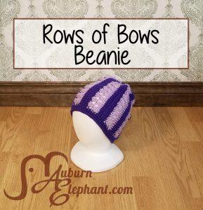 Foam head modeling light and dark purple striped crochet rows of bows beanie