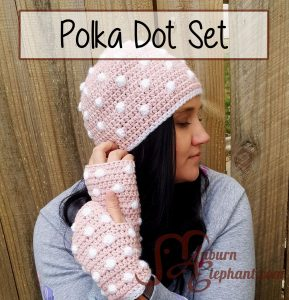 Woman wearing crochet pink and white polka dot hat and fingerless gloves