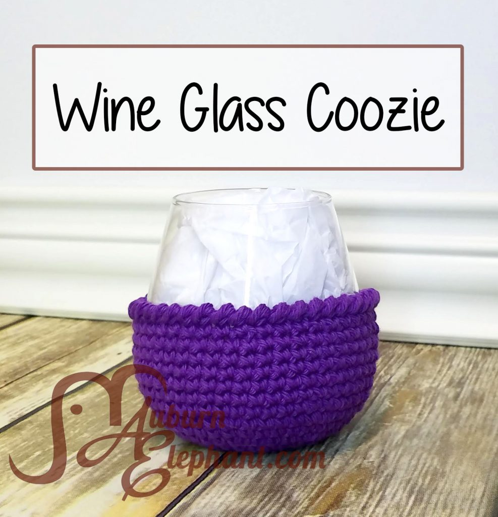 Stemless wine glass with purple crochet coozie