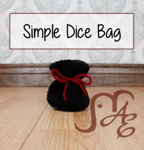 Crochet black dice bag with red tie