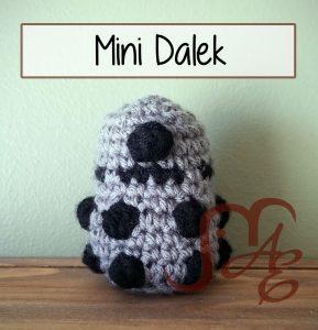 Crochet mini Dalek in grey and black