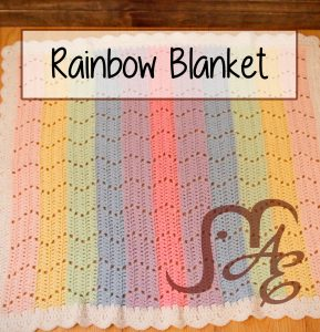 Crochet blanket in rainbow colors with zig zag pattern