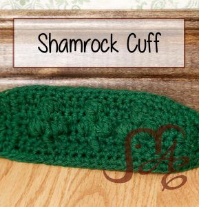 Crochet green cuff with shamrock designs