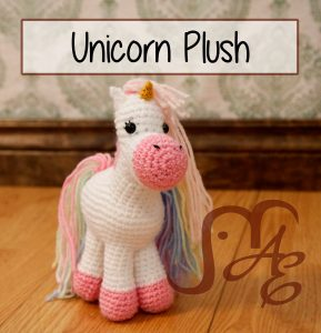 Crochet Unicorn Plush in white and pale rainbow colors