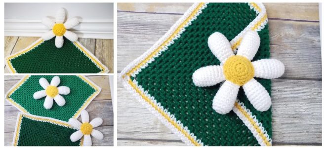 White daisy petals around a yellow center on a green square blanket