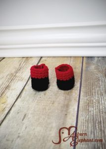 Black and red leg pieces for super hero doll