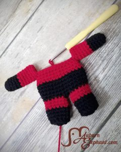 Red and Black super hero doll in progress