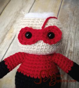 Red mask on super hero doll