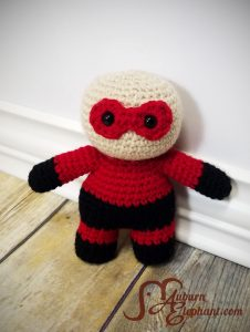 Crochet super hero doll without hair in red and black