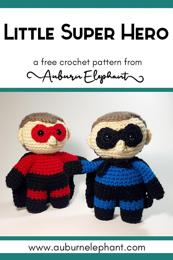 Crochet super hero dolls standing side by side in red and blue